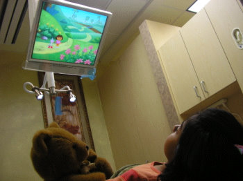 Kid watching TV in dental chair at Fremont Dentist office